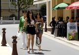 Kim Kardashian shows cleavage and legs walking in the streets in Monaco where she will attend the Monaco Television Festival