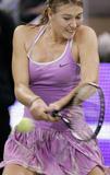 http://img140.imagevenue.com/loc325/th_72693_maria_sharapova_wining_wta_tennis_tournament_madrid_spain_7_122_325lo.jpg