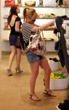 Hilary Duff in denim shorts showing her legs at Barney's in New York City